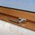 Мансардное окно Fakro ручка эксклюзив цвет золотой дуб